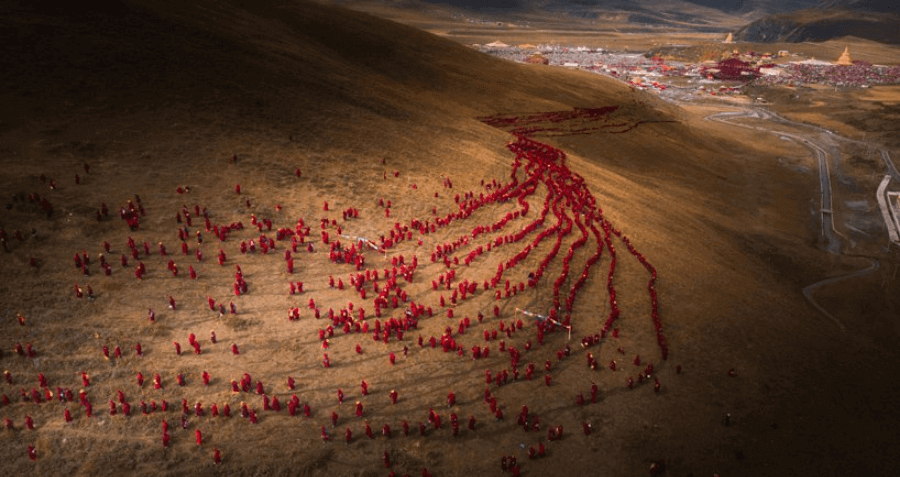 a red river of faith by lifeng chen, china, shortlist, open, culture, 'thousands of women buddhists line up the hillside to go to the mountains to practice the dharma, which is called da yuan sheng hui, in sichuan, china.